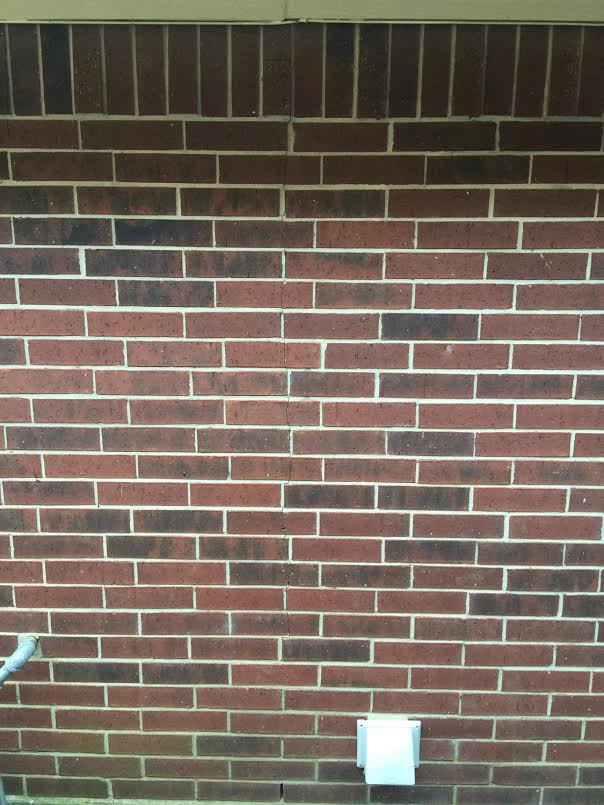 after cracked brick repaired on house